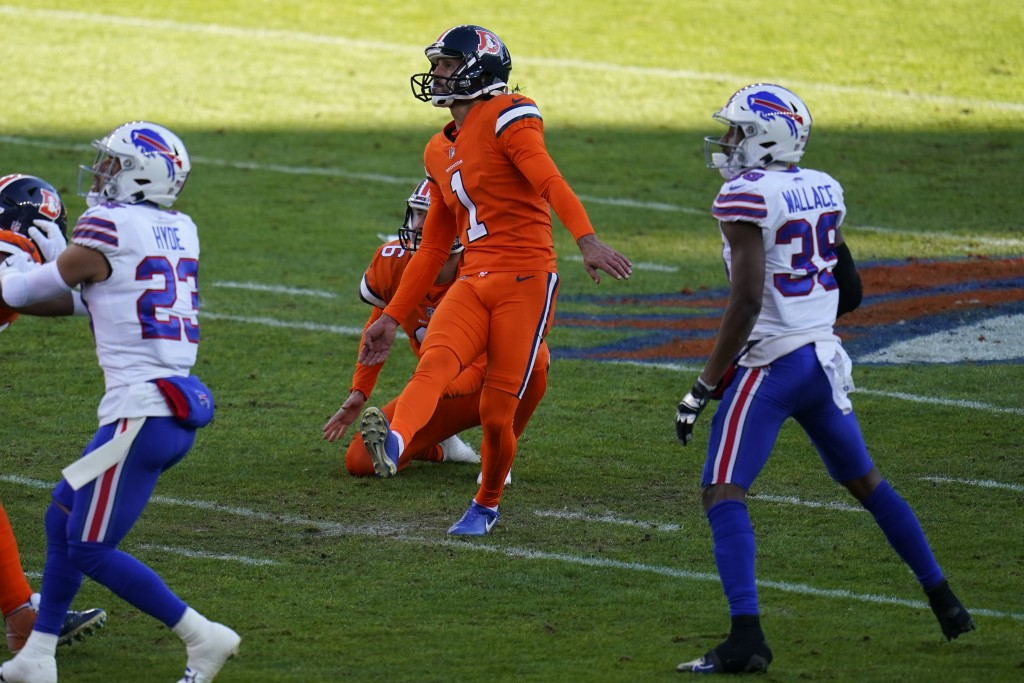Denver Broncos kicker Taylor Russolino looks on as misses a field goal attempt during the first half of an NFL football game against the Buffalo Bills...