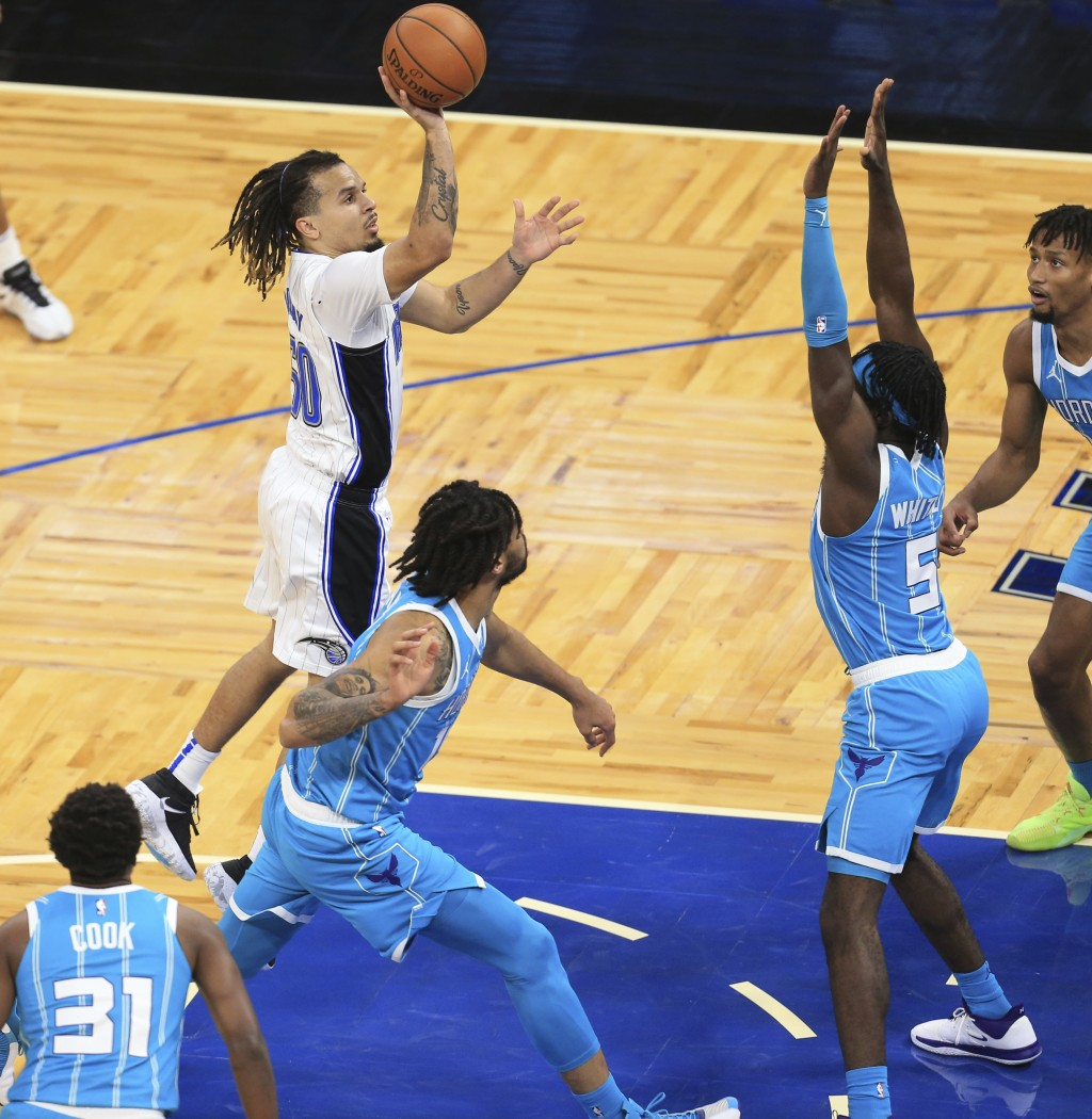 Orlando Magic guard Cole Anthony (50) makes the go-ahead basket over Charlotte Hornets forward Kahlil Whitney (5) late the second half of an NBA baske...