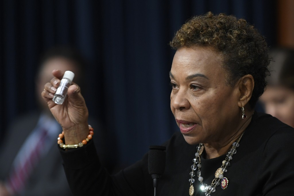 FILE - In this March 11, 2020, file photo Rep. Barbara Lee, D-Calif., holds up a bottle of hand sanitizer as she questions Treasury Secretary Steven M...