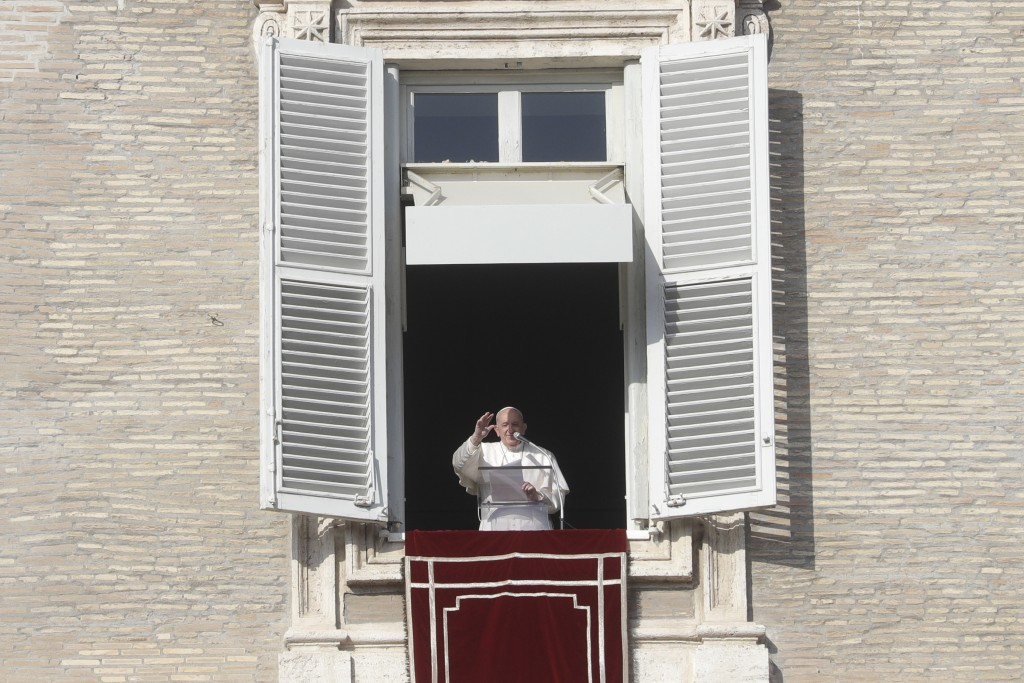 Pope Francis delivers the Angelus noon prayer in St. Peter's Square at the Vatican, Sunday, Dec. 20, 2020. (AP Photo/Gregorio Borgia)
