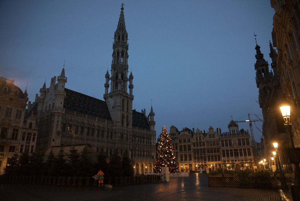A refuse collector works in the historical Grand Place in Brussels, Sunday, Dec. 20, 2020. The EU and the United Kingdom were still working Sunday on ...