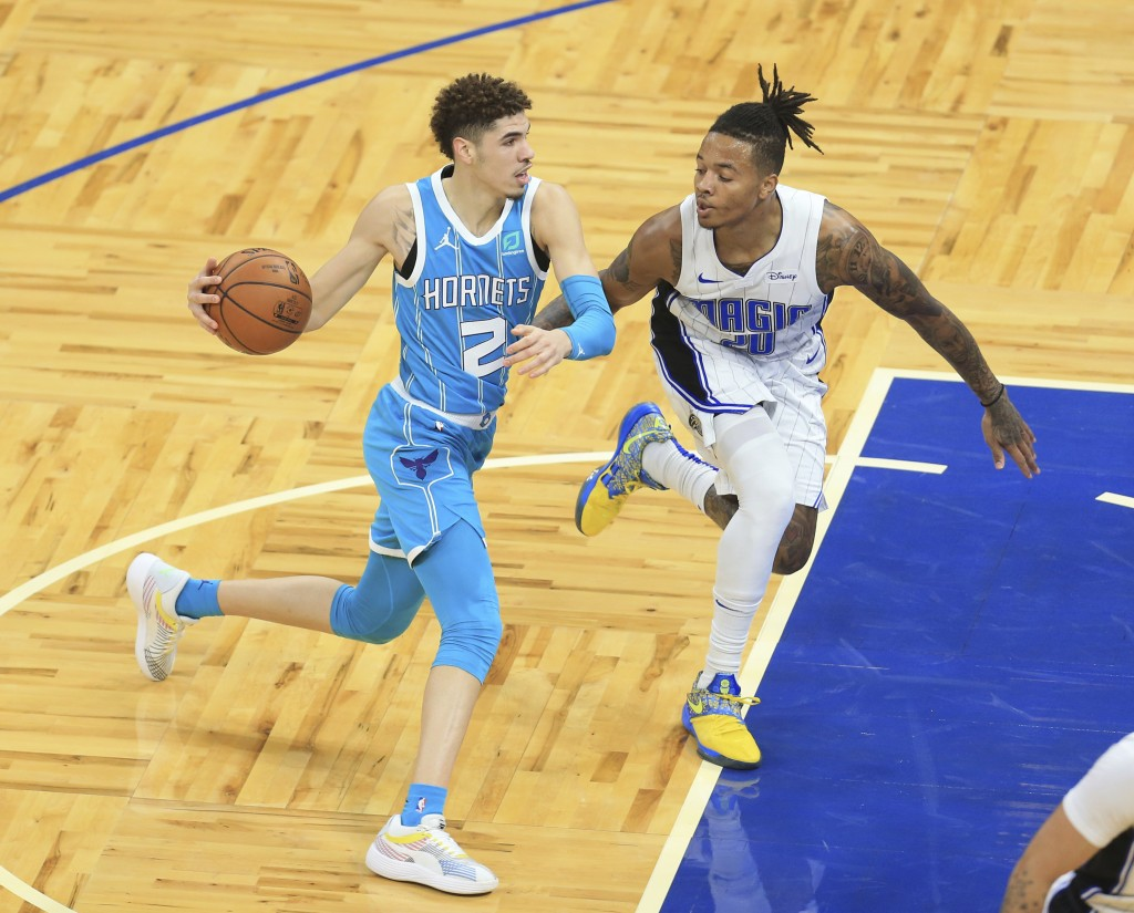 Charlotte Hornets guard LaMelo Ball (2) dribbles around Orlando Magic guard Markelle Fultz (20) during the first half of an NBA basketball game, Satur...