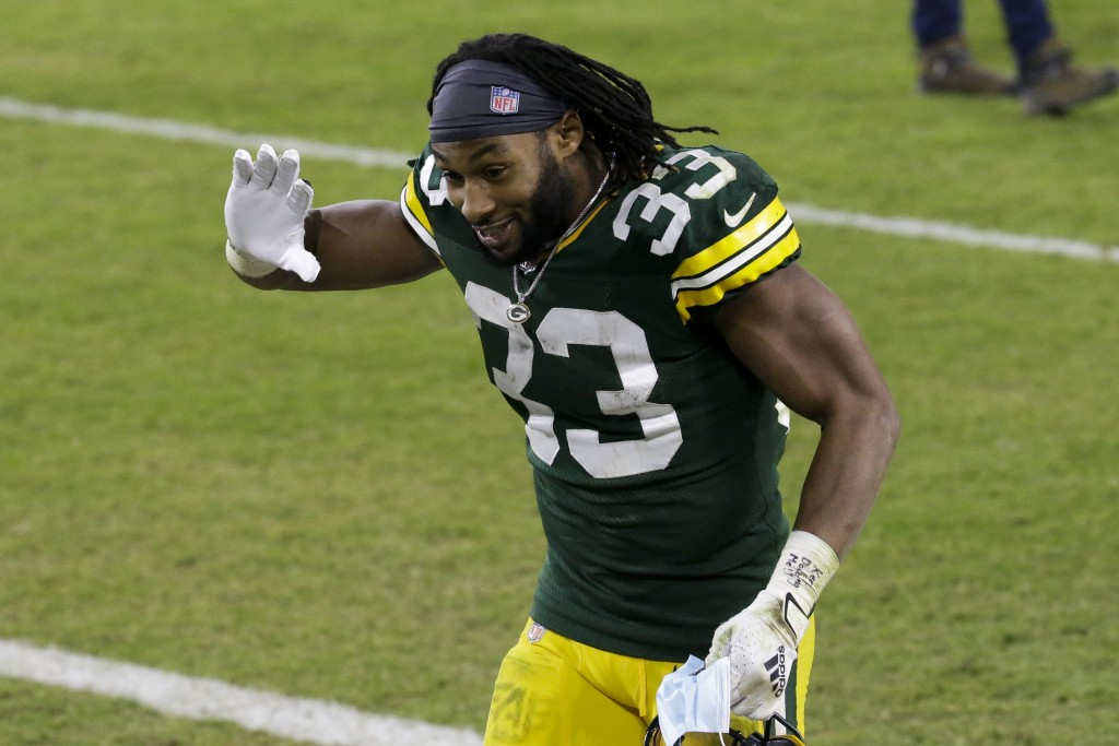 Green Bay Packers' Aaron Jones waves as he runs off the field after an NFL football game against the Carolina Panthers Saturday, Dec. 19, 2020, in Gre...