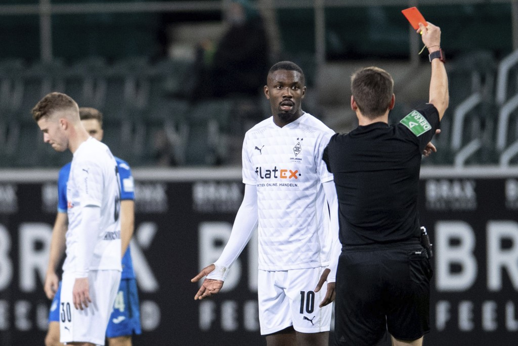 Referee Frank Willenborg shows Moenchengladbach's Marcus Thuram the red card during their German Bundesliga soccer match between Borussia Moenchenglad...
