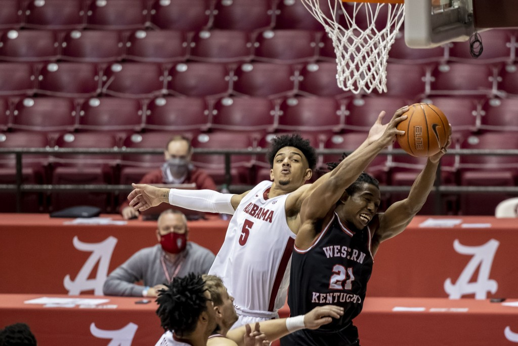 Alabama guard Jaden Shackelford (5) pressures Western Kentucky guard Kenny Cooper (21) as Cooper rebounds the ball during the second half of an NCAA c...