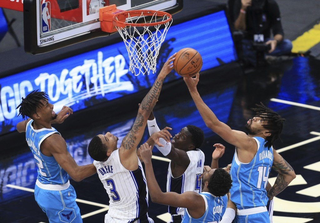 Orlando Magic forward Chuma Okeke (3) blocks the shot of Charlotte Hornets center Nick Richards (14) that would have given the Hornets the lead late i...