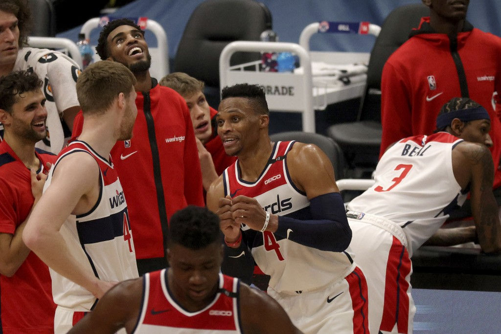 Washington Wizards Russell Westbrook (4) talks with Washington Wizards Davis Bertans (42) during the first half of a preseason NBA basketball game aga...