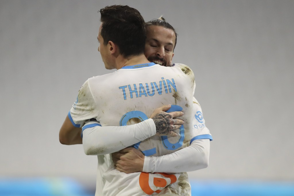 Marseille's Florian Thauvin celebrates his goal with his teammate Dario Benedetto against Rennes during the French League One soccer match between Mar...