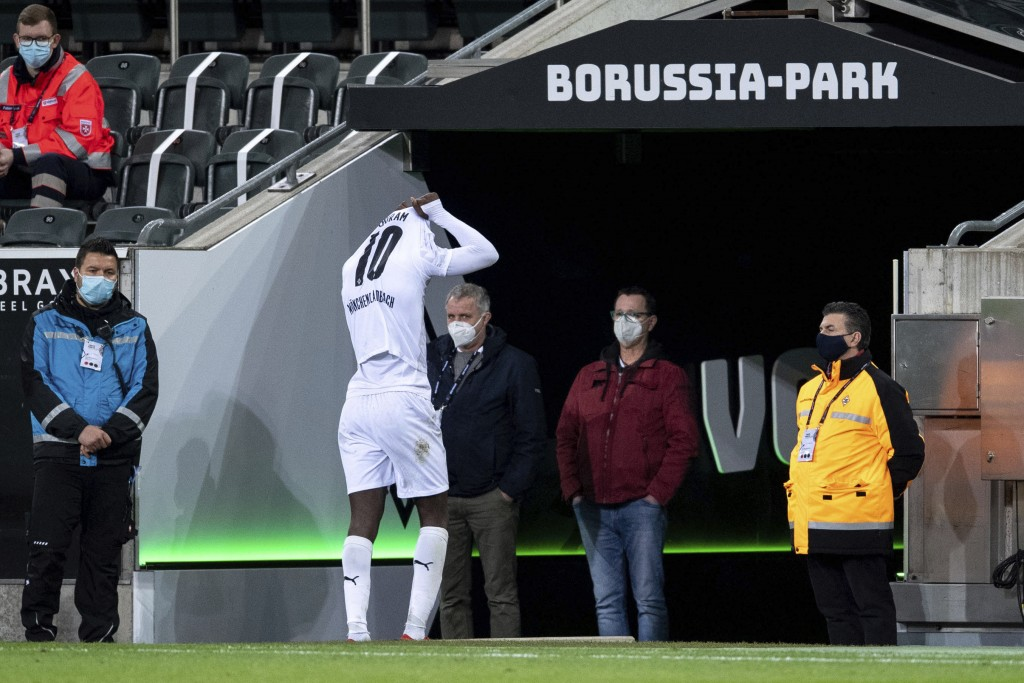 Moenchengladbach's Marcus Thuram leaves the pitch after getting a red card during their German Bundesliga soccer match between Borussia Moenchengladba...