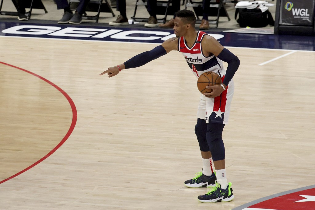 Washington Wizards Russell Westbrook brings the ball up the floor during the first half of a preseason NBA basketball game against the Detroit Pistons...