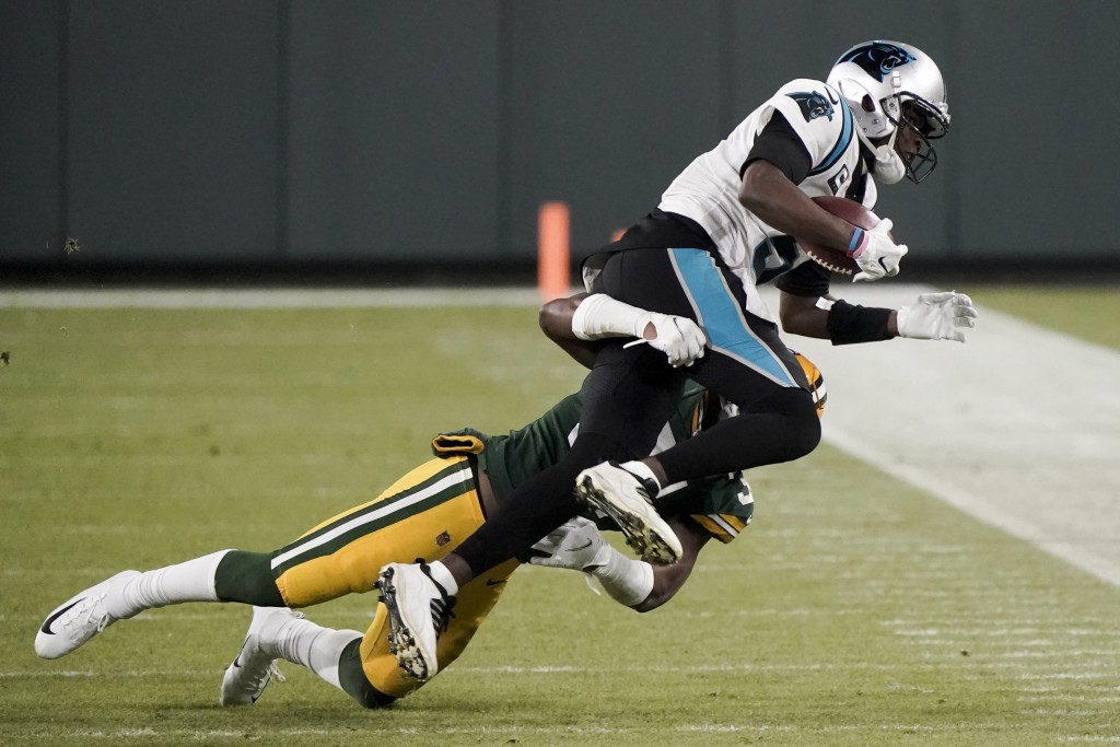 Green Bay Packers' Adrian Amos stops Carolina Panthers' Teddy Bridgewater during the second half of an NFL football game Saturday, Dec. 19, 2020, in G...