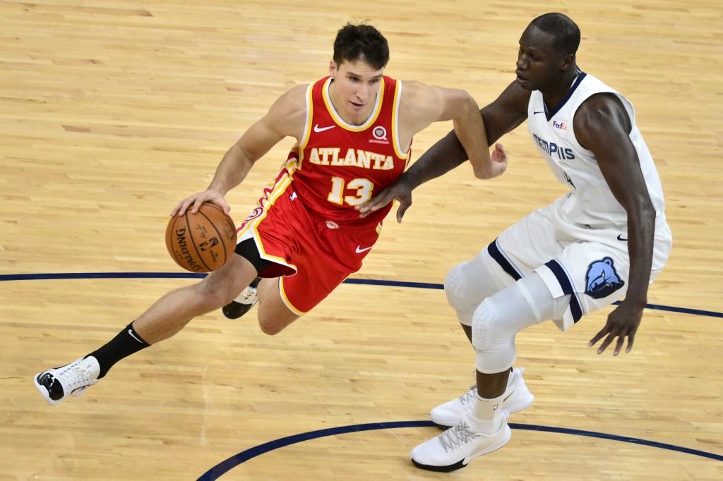 Atlanta Hawks guard Bogdan Bogdanovic (13) drives against Memphis Grizzlies center Gorgui Dieng (14) in the second half of an NBA preseason basketball...