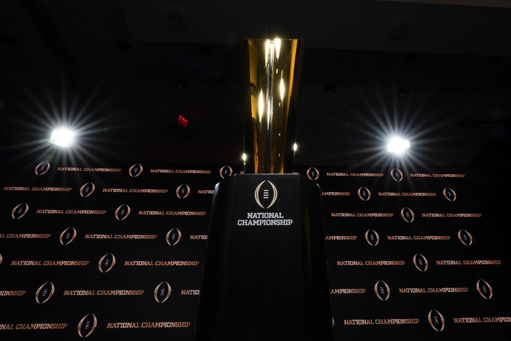 FILE - In this Sunday, Jan. 12, 2020, file photo, the trophy is displayed before a news conference for the NCAA College Football Playoff national cham...