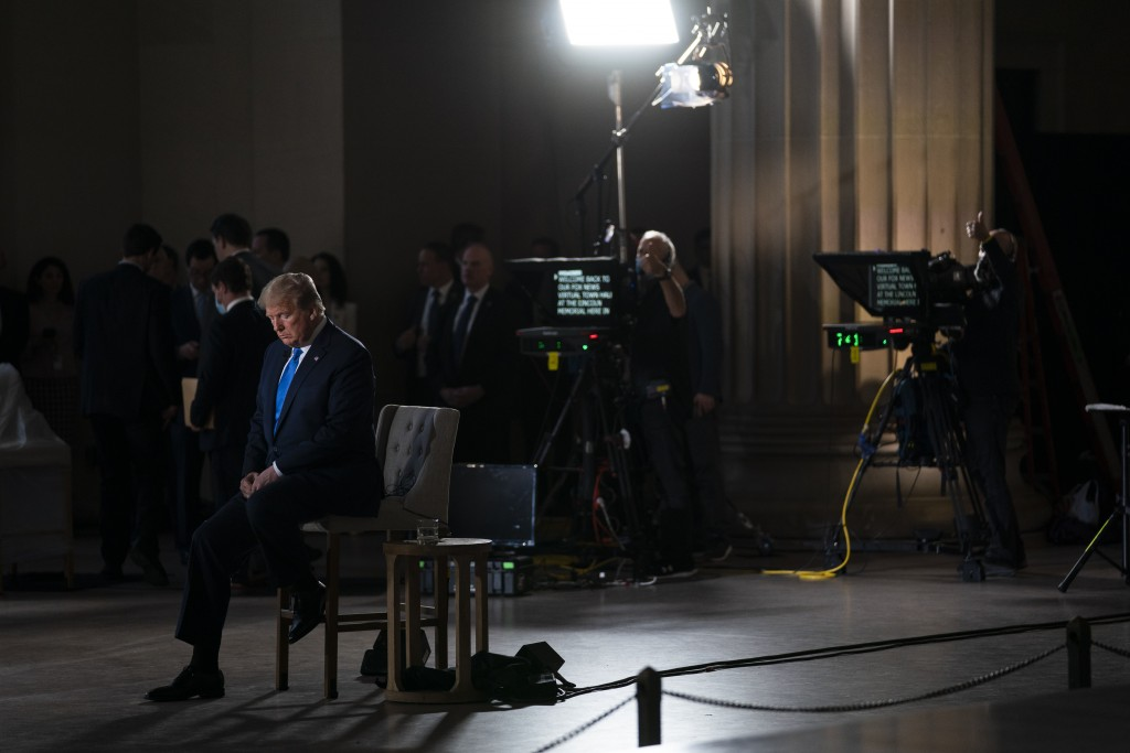 FILE - In this May 3, 2020, file photo President Donald Trump waits for a segment to start during a Fox News virtual town hall from the Lincoln Memori...
