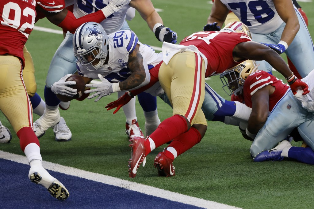 Dallas Cowboys running back Tony Pollard (20) breaks through tackle attempt to reach the end zone for a touchdown in the first half of an NFL football...