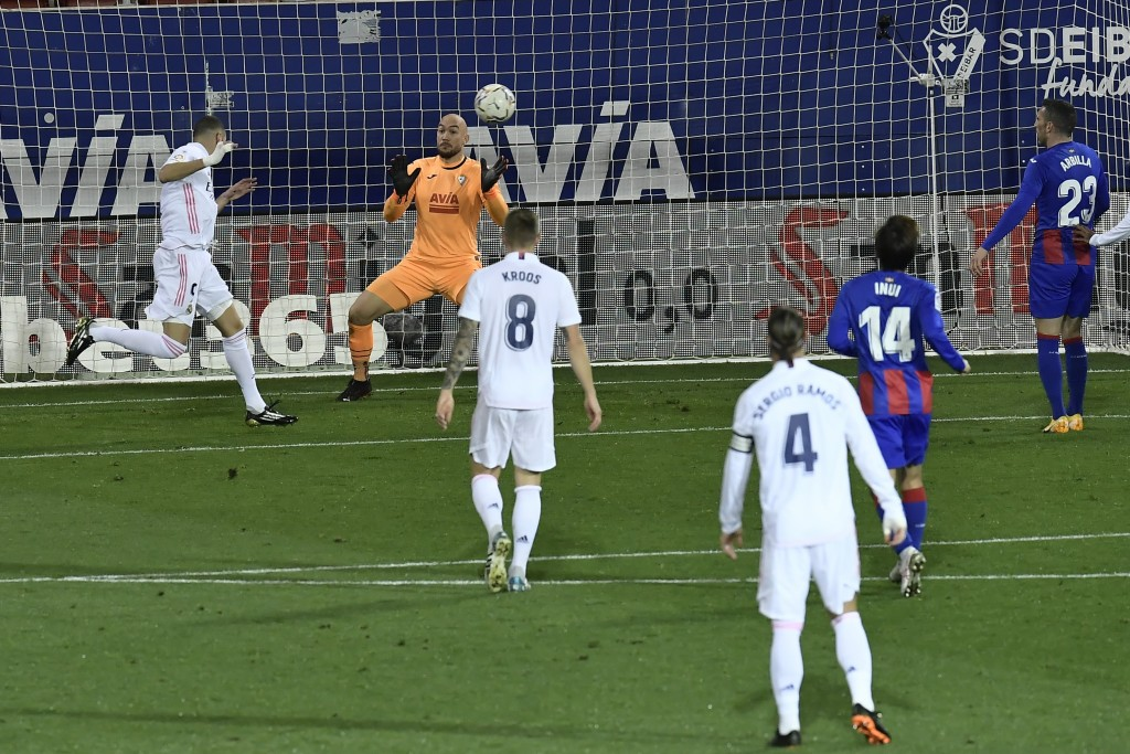 Real Madrid's Karim Benzema, top left, misses an opportunity on a goal in front Eibar's goalkeeper Marko Dmitrovic during the Spanish La Liga soccer m...