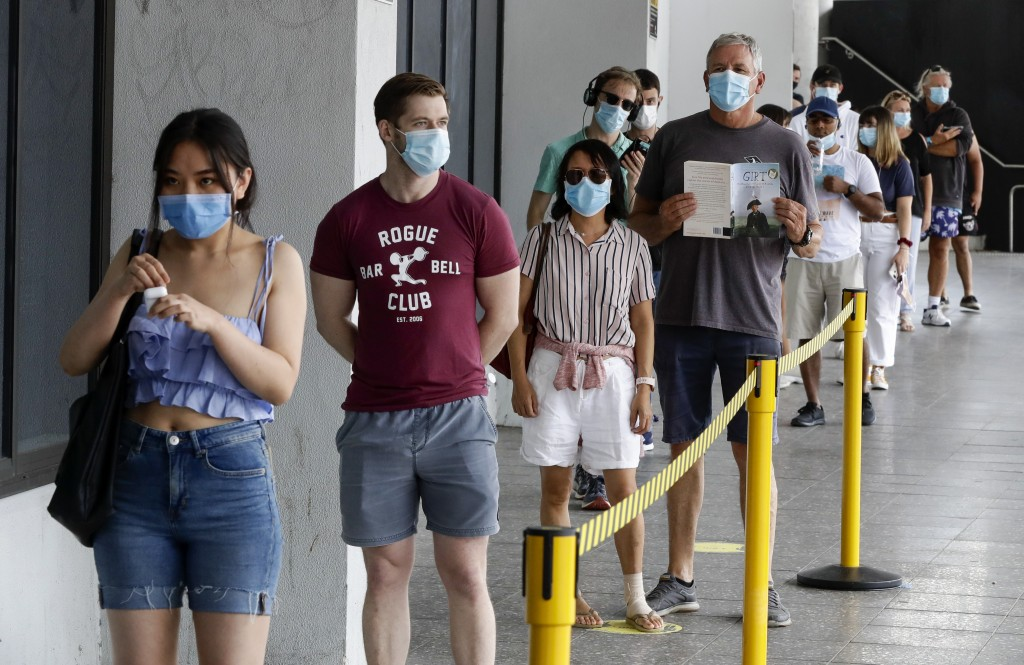 People wait in a line at a COVID-19 testing station on the northern beaches in Sydney, Australia, Monday, Dec. 21, 2020. Sydney's northern beaches are...