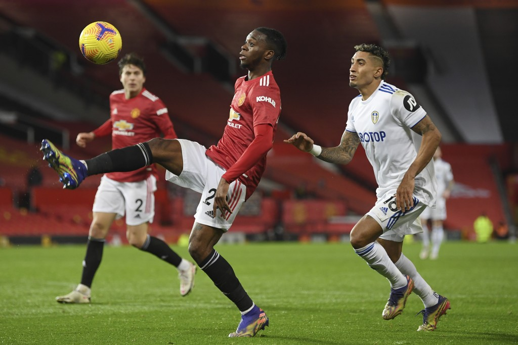 Manchester United's Victor Lindelof controls the ball in front of Leeds United's Raphinha during an English Premier League soccer match between Manche...