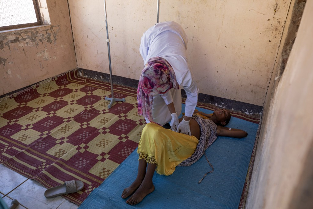 A Sudanese midwife checks a malnourished pregnant refugee woman from Ethiopia's Tigray region, inside the Mercy Corps clinic at Umm Rakouba refugee ca...