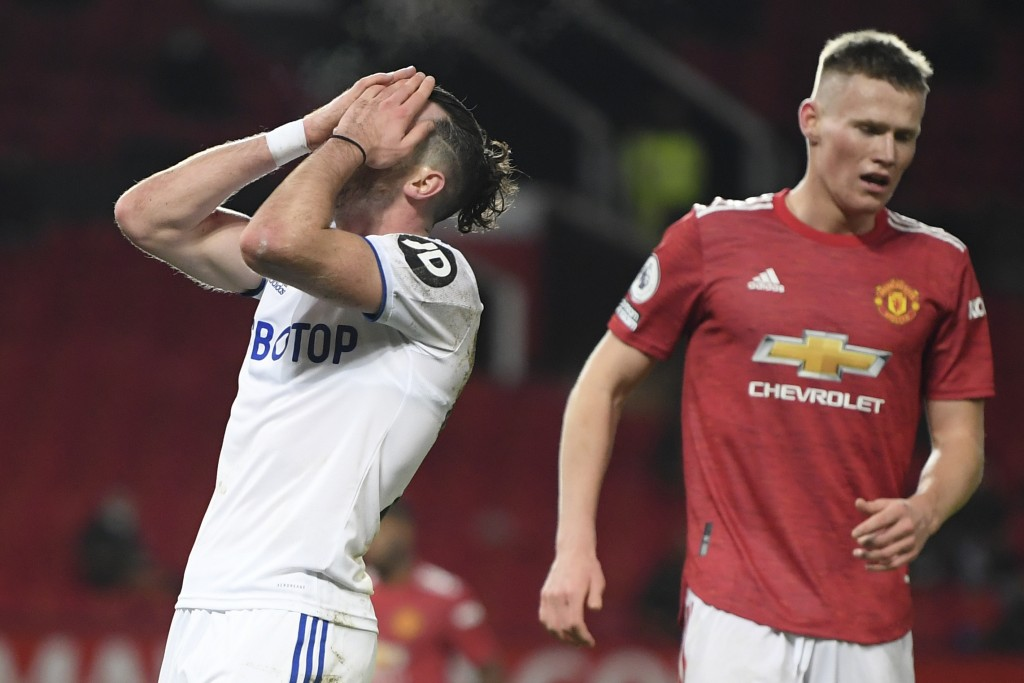Leeds United's Jack Harrison, left, reacts next top Manchester United's Scott McTominay during an English Premier League soccer match between Manchest...