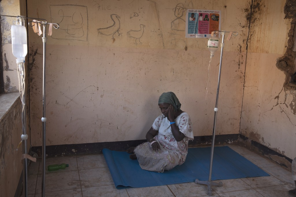 A woman who fled the conflict in Ethiopia's Tigray region waits to get treatment at a clinic in Umm Rakouba refugee camp in Qadarif, eastern Sudan, We...