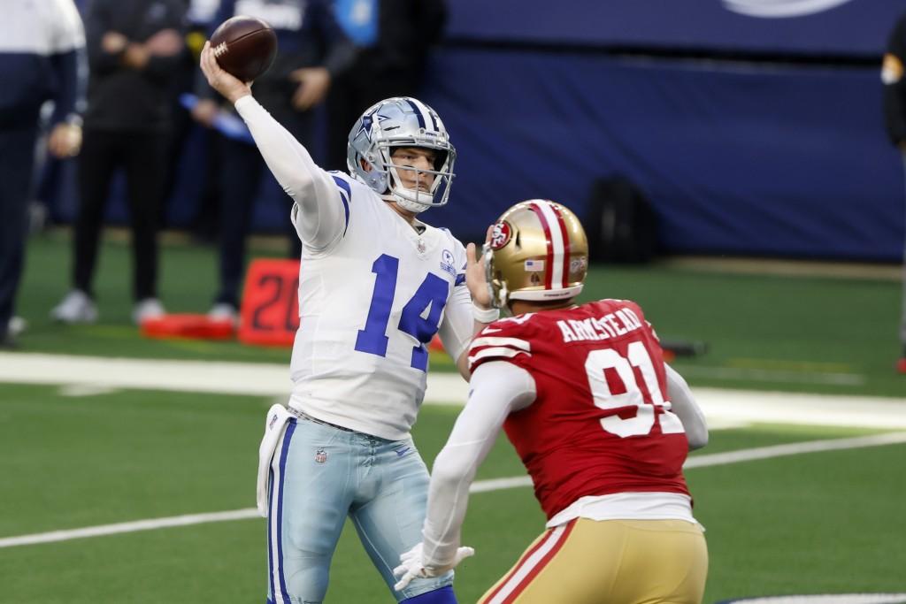 Dallas Cowboys quarterback Andy Dalton (14) throws a touchdown pass to Michael Gallup under pressure from San Francisco 49ers defensive end Arik Armst...
