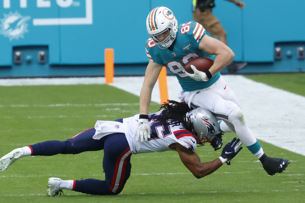 England Patriots defensive back Kyle Dugger (35) tackles Miami Dolphins tight end Adam Shaheen (80) during the first half of an NFL football game, Sun...