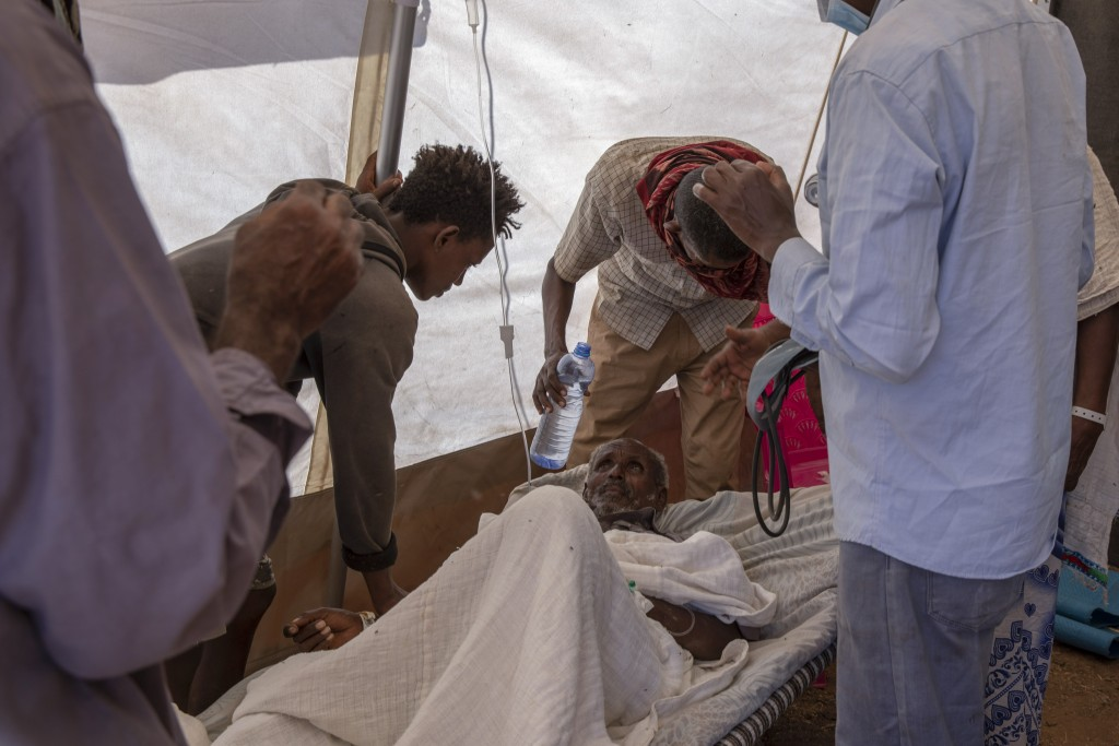 Nurses tend to an elderly man inside a clinic run by Doctors Without Borders in the Umm Rakouba refugee camp in Qadarif, eastern Sudan, Monday, Dec. 1...