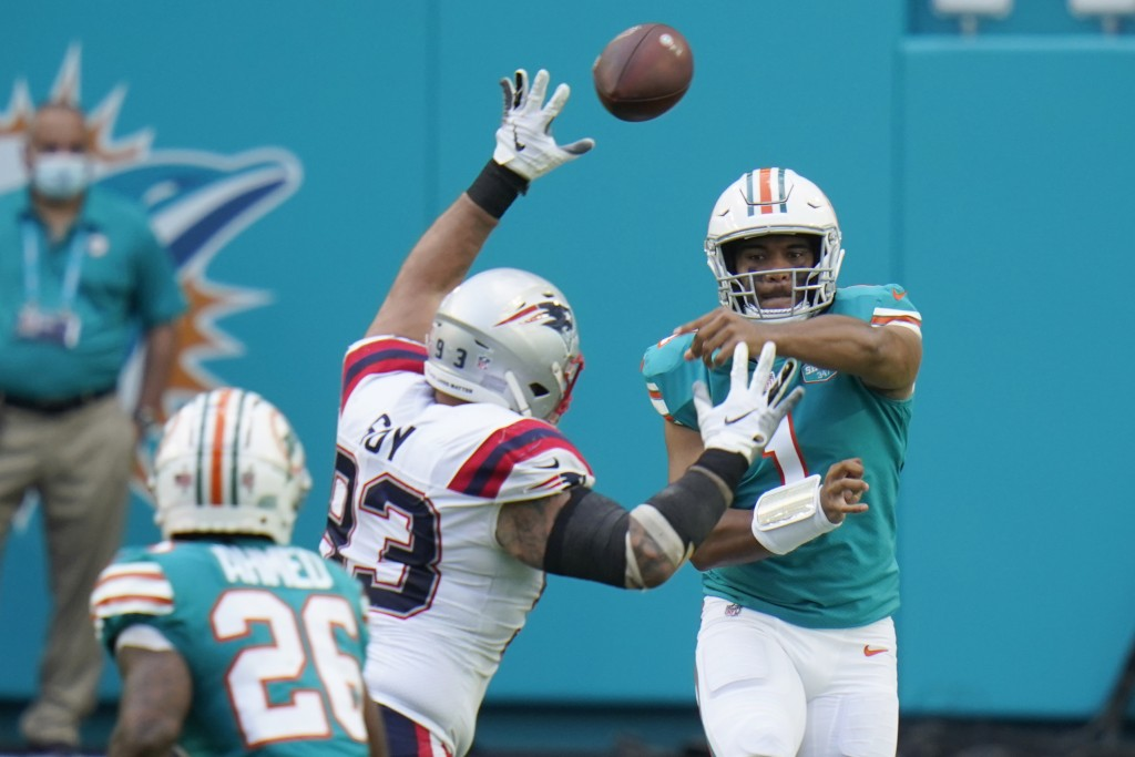 Miami Dolphins quarterback Tua Tagovailoa (1) throws a pass to running back Salvon Ahmed (26) during the first half of an NFL football game against th...