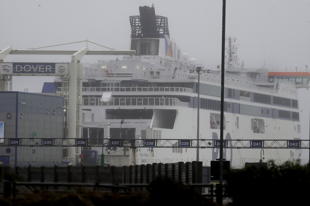A passenger ferry waits at the closed ferry terminal in Dover, England, Monday, Dec. 21, 2020, after the Port of Dover was closed and access to the Eu...