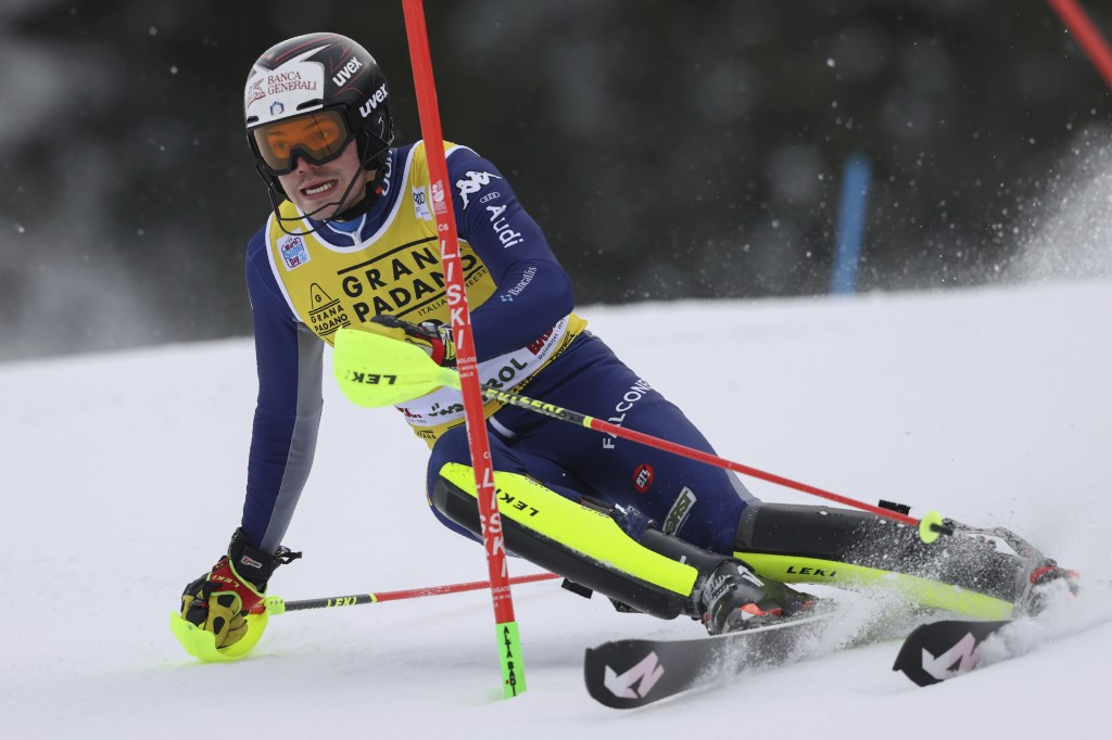 Italy's Alex Vinatzer speeds down the course during an alpine ski, men's World Cup slalom in Alta Badia, Italy, Monday, Dec.21, 2020. (AP Photo/Alessa...