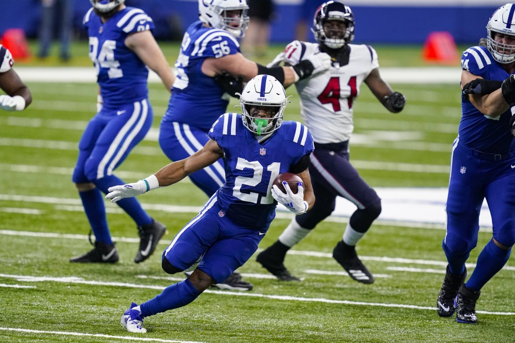 Indianapolis Colts running back Nyheim Hines (21) runs against the Houston Texans in the first half of an NFL football game in Indianapolis, Sunday, D...