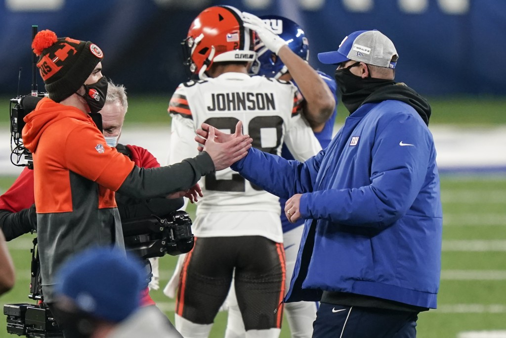 Cleveland Browns head coach Kevin Stefanski, left, shakes hands with New York Giants head coach Joe Judge after an NFL football game, Sunday, Dec. 20,...