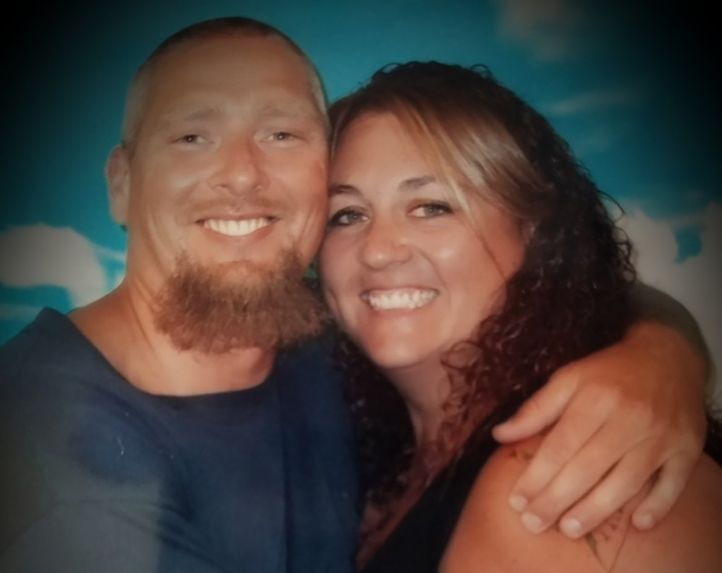 In this undated photo provided by Amy Wallace, her and her husband, Jerry Wallace, who is incarcerated at Kinross Correctional Facility and recovered ...