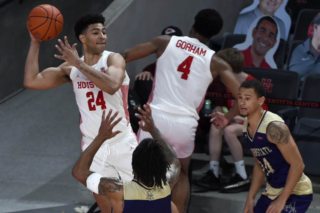 Houston guard Quentin Grimes (24) saves the ball from going out of bounds during the second half of an NCAA college basketball game against Alcorn Sta...