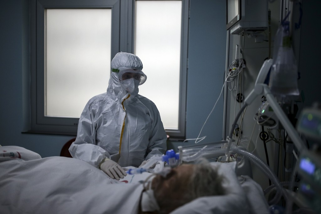 Nurse Ilknur Bastan tends to a patient infected with COVID-19, at the intensive care unit of the Dr Ilhan Varank Hospital in Istanbul, Saturday, Dec. ...