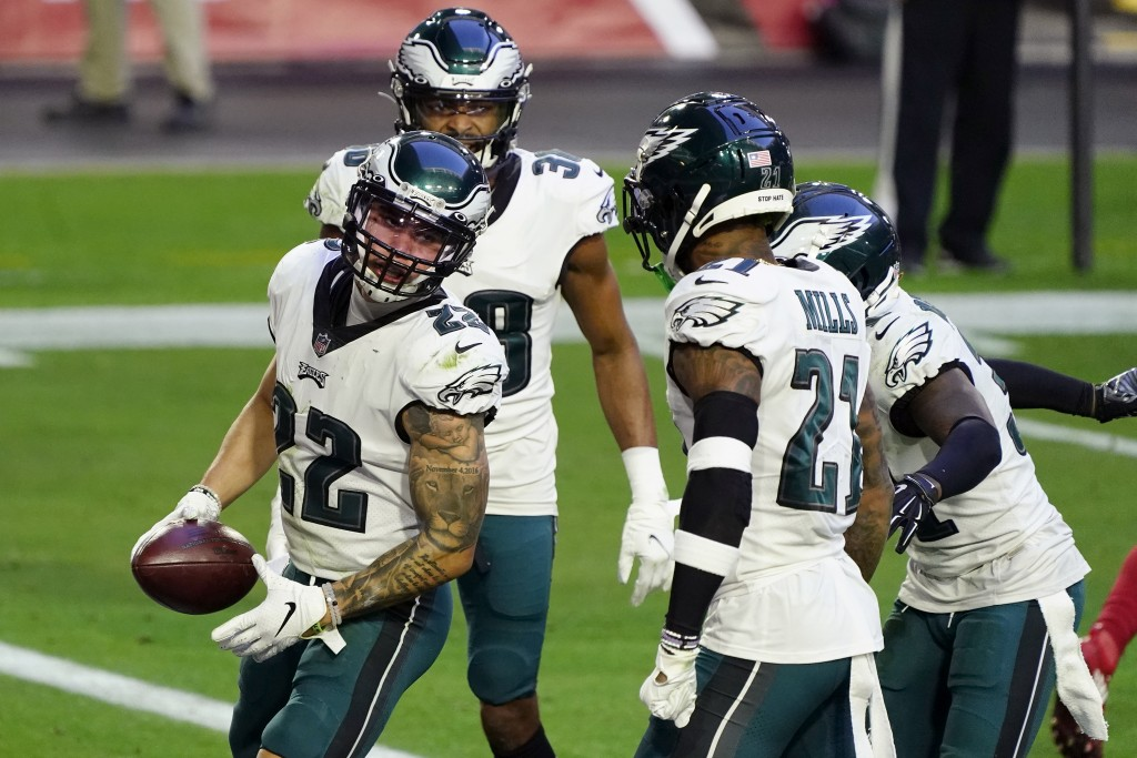 Philadelphia Eagles safety Marcus Epps (22) celebrates his interception against the Arizona Cardinals with teammates during the second half of an NFL ...
