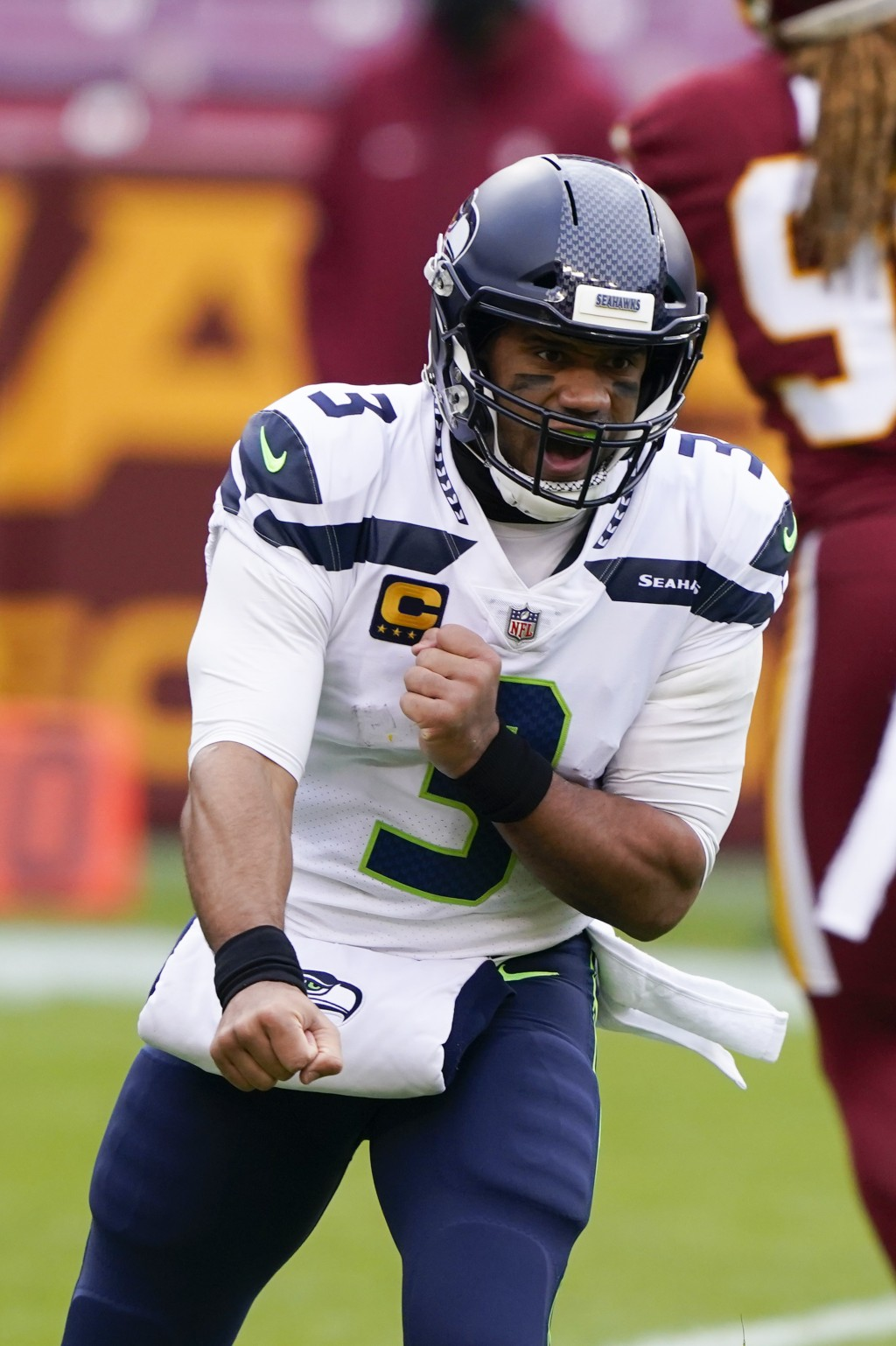 Seattle Seahawks quarterback Russell Wilson (3) celebrating his touchdown pass to tight end Jacob Hollister (86) during the first half of an NFL footb...