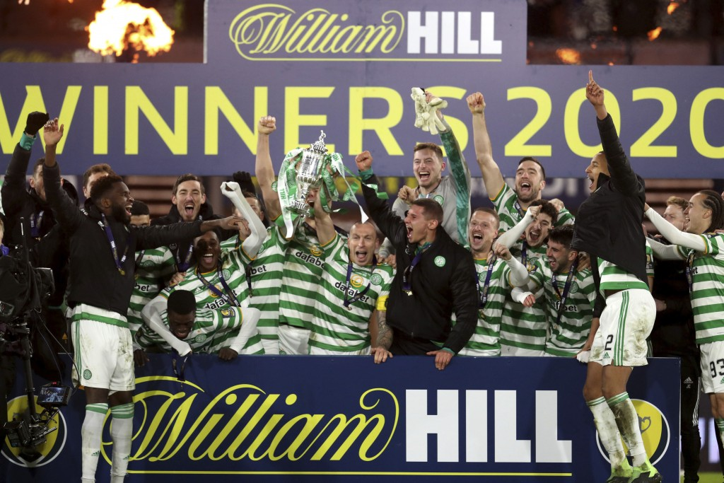Celtic celebrate winning the Scottish Cup final with the trophy, after the Scottish Cup Final soccer match between Celtic and Heart of Midlothian at H...