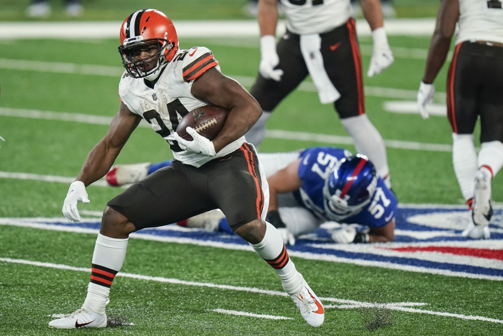 Cleveland Browns' Nick Chubb (24) rushes during the second half of an NFL football game against the New York Giants Sunday, Dec. 20, 2020, in East Rut...
