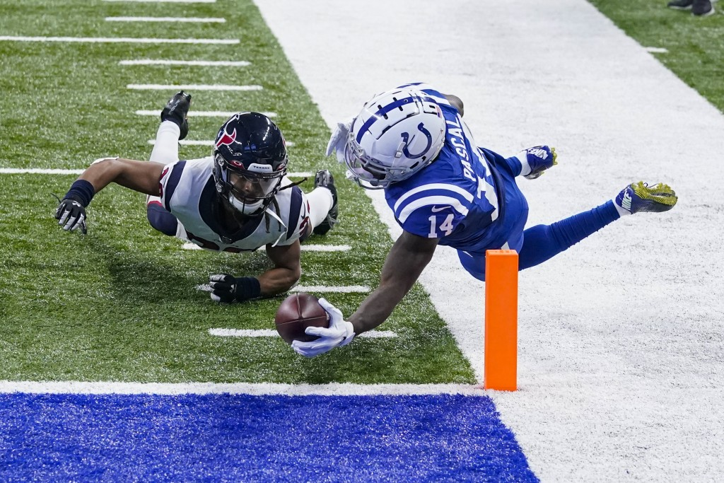 Indianapolis Colts wide receiver Zach Pascal (14) goes over Houston Texans cornerback Vernon Hargreaves III (26) for a touchdown in the second half of...