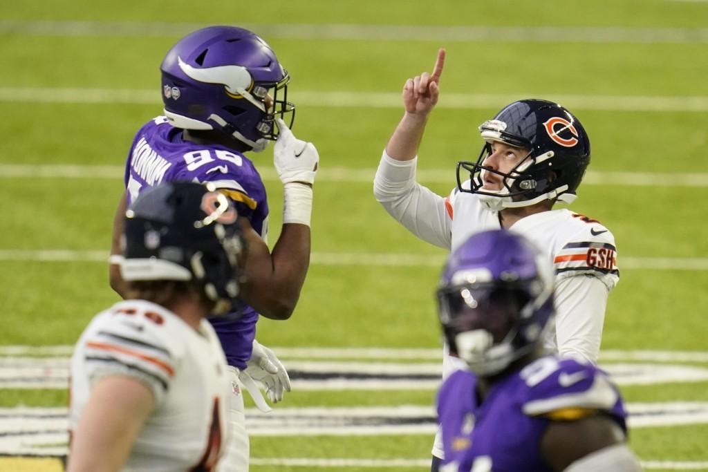 Chicago Bears place kicker Cairo Santos celebrates in front of Minnesota Vikings defensive end D.J. Wonnum, left, after kicking a 48-yard field goal d...