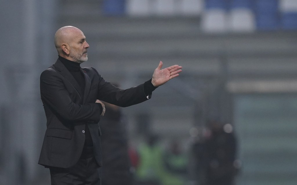 Milan coach Stefano Pioli gestures during the Italian Serie A soccer match between Sassuolo and Milan, at the Mapei stadium in Reggio Emilia, Italy, S...