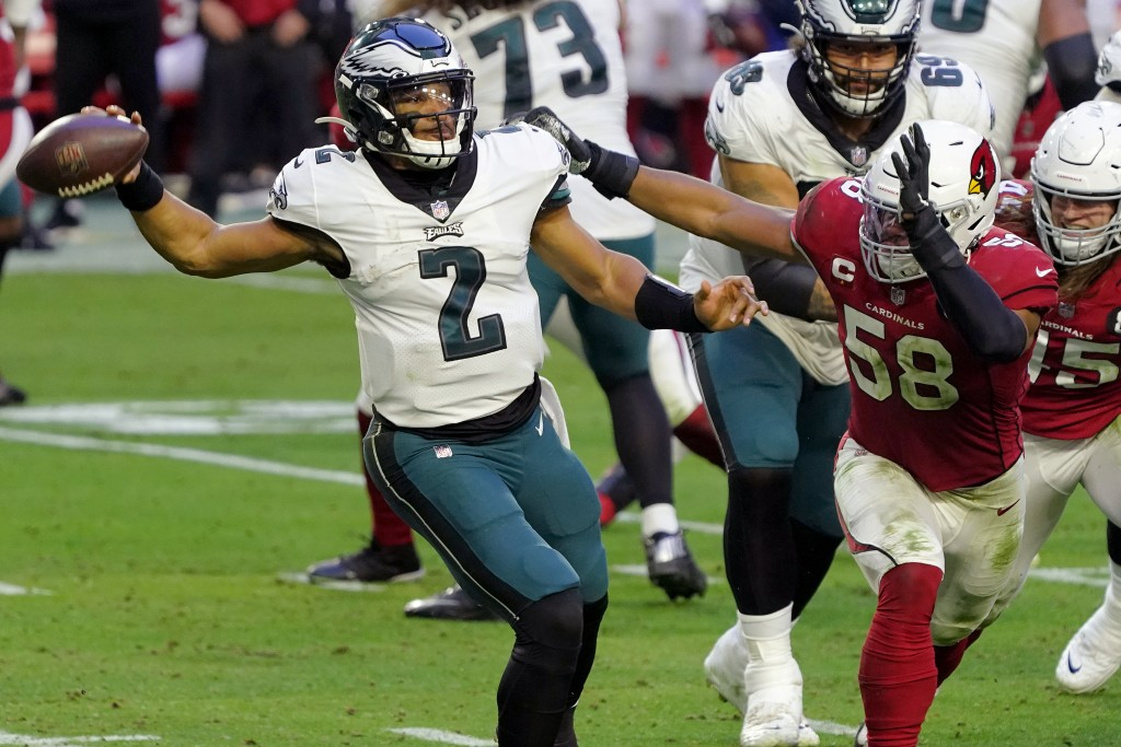 Philadelphia Eagles quarterback Jalen Hurts (2) throws under pressure from Arizona Cardinals middle linebacker Jordan Hicks (58) during the second hal...