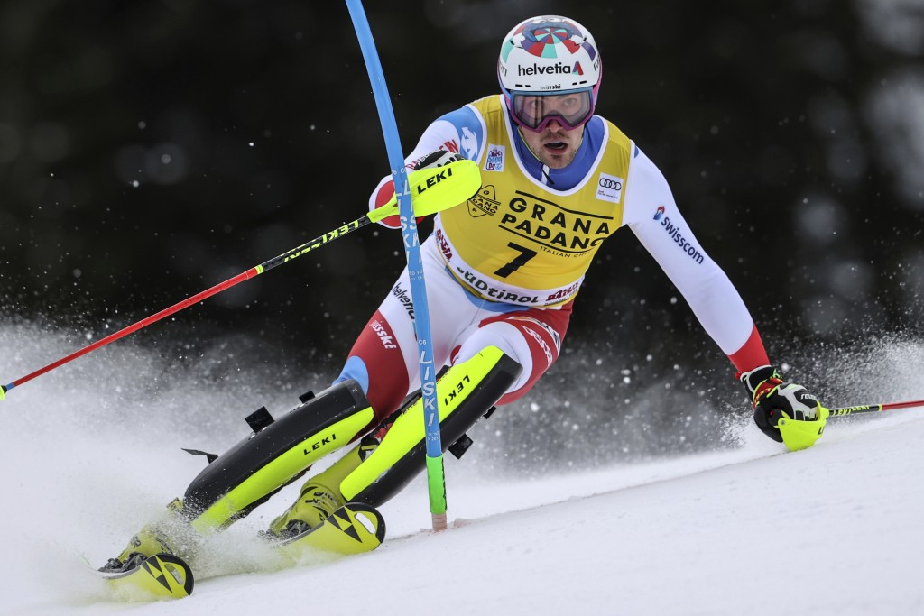 Switzerland's Daniel Yule speeds down the course during an alpine ski, men's World Cup slalom in Alta Badia, Italy, Monday, Dec.21, 2020. (AP Photo/Al...