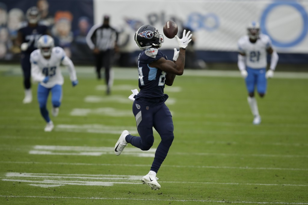 Tennessee Titans wide receiver Corey Davis catches a touchdown pass against the Detroit Lions during the first half of an NFL football game Sunday, De...