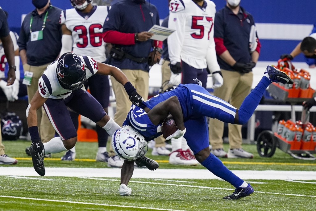 Indianapolis Colts wide receiver Zach Pascal (14) is tackled by Houston Texans cornerback Vernon Hargreaves III (26) in the first half of an NFL footb...