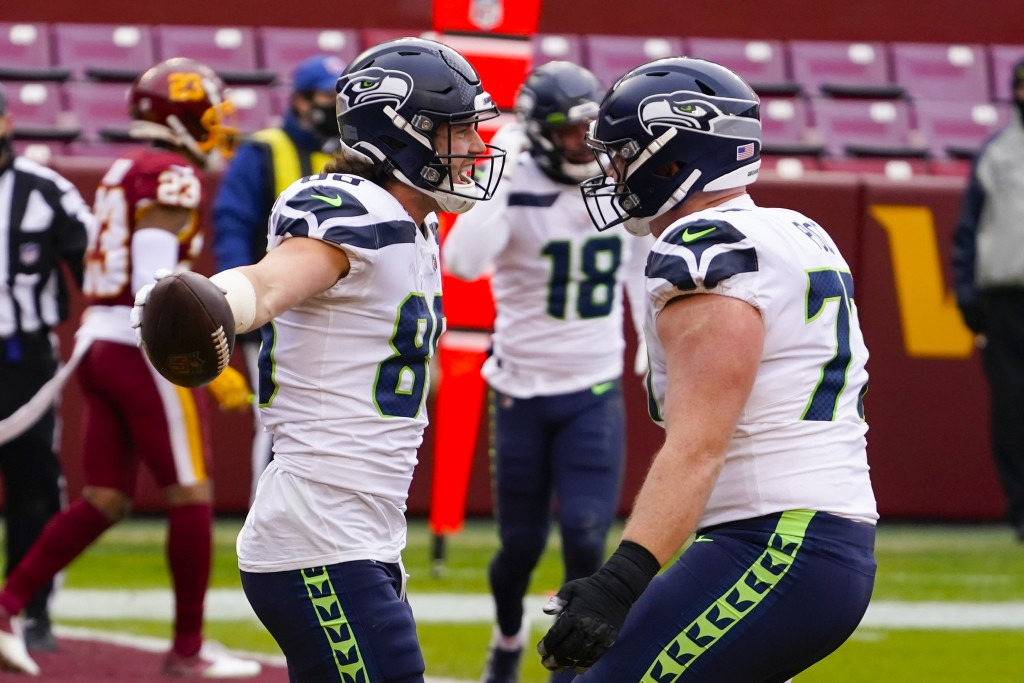 Seattle Seahawks tight end Jacob Hollister (86) celebrating his touchdown with teammate Seattle Seahawks center Ethan Pocic (77) during the first half...