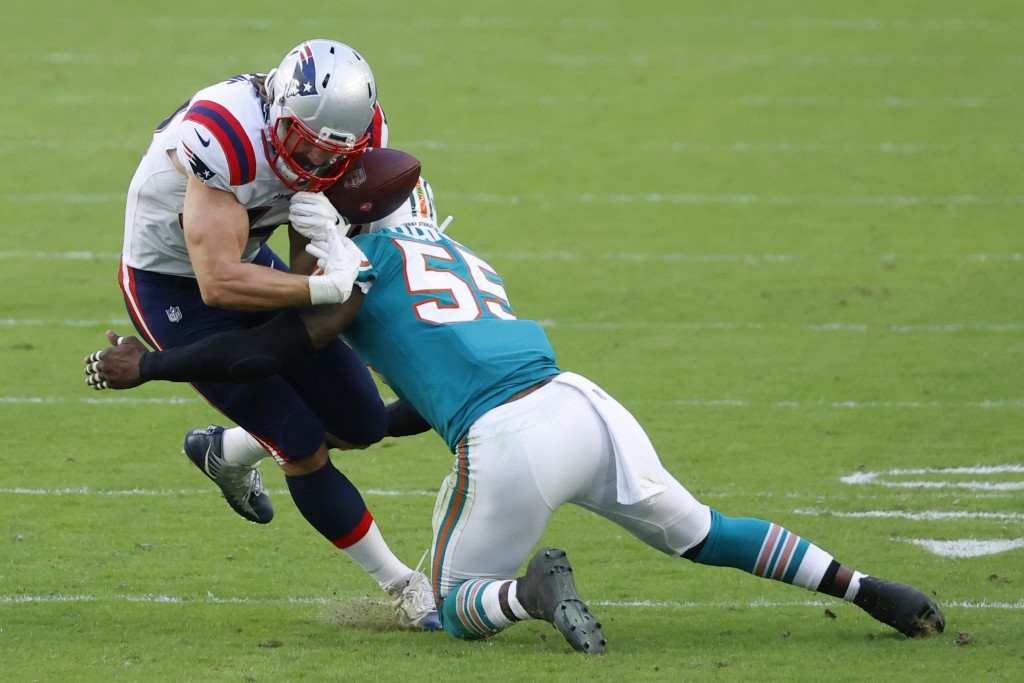 New England Patriots tight end Dalton Keene (44) fumbles the ball on a tackle by Miami Dolphins outside linebacker Jerome Baker (55), during the secon...