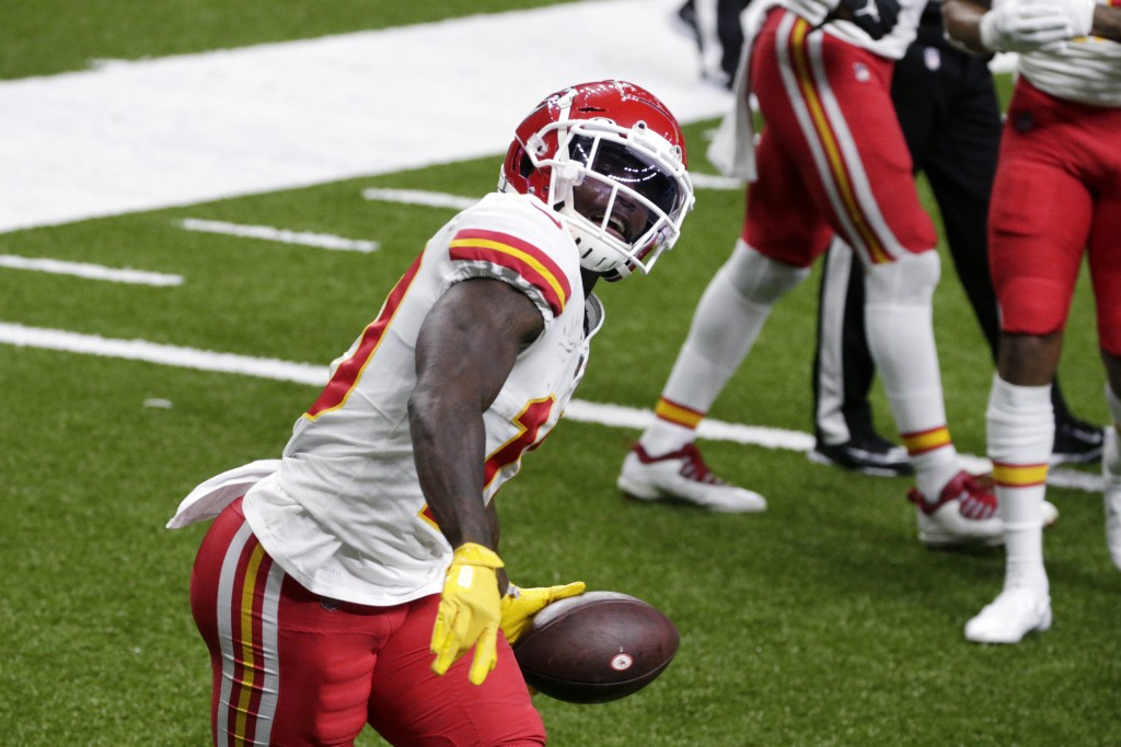 Kansas City Chiefs wide receiver Tyreek Hill celebrates his touchdown reception in the first half of an NFL football game against the New Orleans Sain...